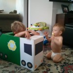 Boys in homemade garbage truck